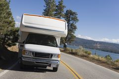 RV driving on mountain road Royalty Free Stock Images