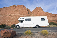 RV in front of red rocks Royalty Free Stock Photos
