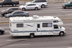 RV on the highway in United States. DALLAS, USA - APR 8: White recreational vehicle on the highway in the United States. April 8, 2016 in Dallas, Texas, USA stock photo