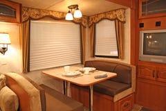 Rv interior - cenando Imagen de archivo