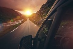 RV Motorhome Traveling. Scenic Mountain Route with Sunset. Summer Camper Trip Stock Photo