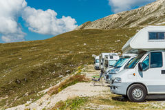 RV Motorhomes Camping. In High Alpine Place. Scenic Campers Campground stock photo
