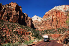 RV Mountain Road Trip. An RV cruises on a twisty mountain road Royalty Free Stock Photo