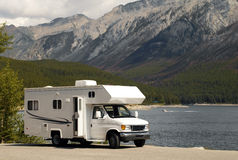 RV near a lake in Banff N.P. in Canada. RV parked near Lake Minnewanka in Banff National Park - British Columbia - Western Canada Stock Photos