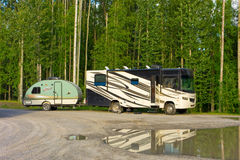 An rv pulling a tear-drop trailer parked in the yukon territories Royalty Free Stock Image