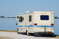 RV recreational vehicle at waterway beach Royalty Free Stock Images