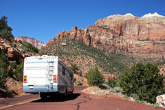 RV Road Trip. A motorhome traveling along a scenic highway Stock Photo