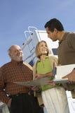 RV Salesperson Talking To Senior Customers. RV salesperson talking to customers low angle view royalty free stock photography