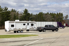 RV and Semi Truck on the rest area Royalty Free Stock Photo