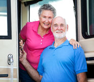 RV Senior Couple. Portrait of senior couple at the door of their luxury RV Stock Photo