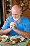 RV Senior Man Says Grace Royalty Free Stock Photos