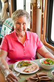 RV Senior Woman Dining Stock Photo