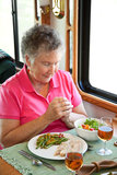 RV Senior Woman Says Grace Stock Photography
