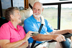 RV Seniors - GPS Navigation. Seniors taking a trip in their motor home, using a GPS to navigate Royalty Free Stock Photos