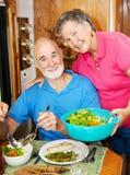 RV Seniors - Serving Dinner royalty free stock photo