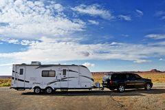RV Trailer Journey. Travel Trailer Pulling by Large Sport Utility Vehicle in Arizona USA. RV Adventures. Recreation Photo Collection Royalty Free Stock Images