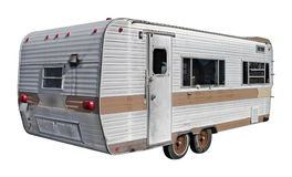 RV Trailer. A recreational vehicle trailer from the past, isolated from the background. Also contains a clipping path Royalty Free Stock Photos