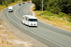 RV travel. Recreational vehicles traveling on the highway Royalty Free Stock Image