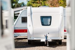 RV Travel Trailer Storage. Parking. Modern Recreational Trailer with Front Window. Camping and Traveling Theme Stock Images