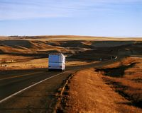 Rv Travelling Down The Hiway Royalty Free Stock Images