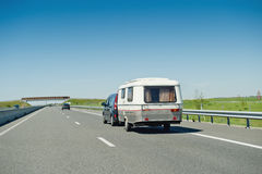 RV van and trailer driving fast to vacance destination Royalty Free Stock Images