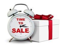 Réveil avec le cadeau, temps au concept de vente sur le blanc Image stock