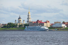 Rver cruise ship Alexander Green in the background of the historical centre of Rybinsk july evening. Yaroslavl region Royalty Free Stock Images