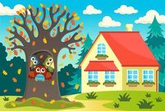 Árvore da coruja perto da casa Fotografia de Stock