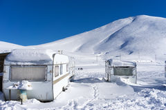 RVs covert in snow at Falakro, in Greece. Royalty Free Stock Photo