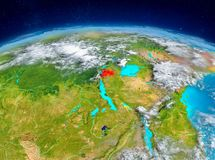 Rwanda on Earth. Orbit view of Rwanda highlighted in red on planet Earth with highly detailed surface textures. 3D illustration. Elements of this image furnished Royalty Free Stock Photography