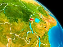 Rwanda on Earth. Space orbit view of Rwanda highlighted in red on planet Earth with visible borders. 3D illustration. Elements of this image furnished by NASA Stock Photography
