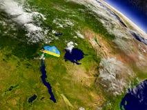 Rwanda with embedded flag on Earth Stock Image
