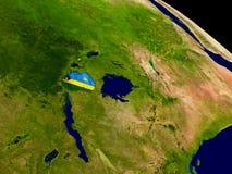 Rwanda with flag on Earth Stock Photography