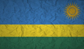 Rwanda flag with the effect of crumpled paper and grunge Stock Images