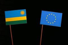 Rwanda flag with European Union EU flag  on black Royalty Free Stock Photography