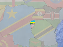 Rwanda with flag on globe Stock Images