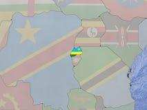 Rwanda with flag on globe Stock Photography