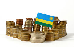 Rwanda flag with stack of money coins Stock Photos