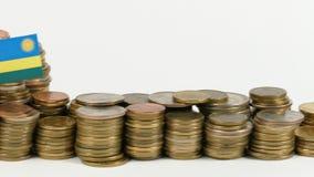 Rwanda flag with stack of money coins. Rwanda flag waving with stack of money coins stock video footage