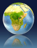 Rwanda on globe with reflection. Illustration with detailed planet surface. Elements of this image furnished by NASA Stock Photos