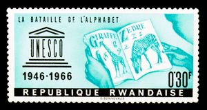 Rwanda postage stamp shows The battle of the alphabet, UNESCO 20th Anniversary series, circa 1966 Stock Photo