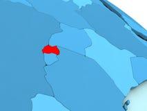 Rwanda in red on blue globe Royalty Free Stock Photo
