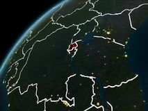 Night over Rwanda. Rwanda in red on planet Earth at night with visible borderlines and city lights. 3D illustration. Elements of this image furnished by NASA Royalty Free Stock Photo