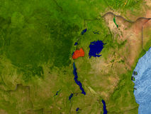 Rwanda in red. Top-down view of Rwanda highlighted in red with surrounding region. 3D illustration with highly detailed realistic planet surface. Elements of Royalty Free Stock Photography