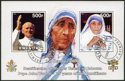 RWANDA -2003: shows Mother Teresa and Pope John Paul II. RWANDA - CIRCA 2003: A stamp printed in Rwanda shows Beautification of Mother Teresa of Calcutta and Royalty Free Stock Images