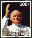 RWANDA - 2003: shows Pope John Paul II - 25th Anniversary of the Pontificate. RWANDA - CIRCA 2003: A stamp printed in Rwanda shows Pope John Paul II - 25th Royalty Free Stock Photography