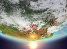 Rwanda with sun. Rwanda during sunrise highlighted in red on planet Earth with clouds. 3D illustration. Elements of this image furnished by NASA Stock Image