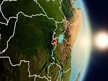 Rwanda during sunrise. Highlighted in red on planet Earth with visible country borders. 3D illustration. Elements of this image furnished by NASA Stock Images