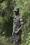Rwandan Military Personnel. Accompany tourists on gorilla treks into the Volcanoes National Park area which borders Democratic Republic of Congo and Uganda Stock Image