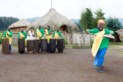 Rwandan musicians and batwa dancer in the village Stock Photos